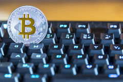 BTC Bitcoin coin on keyboard Royalty Free Stock Image