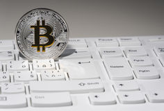 BTC Bitcoin coin on keyboard Royalty Free Stock Images