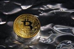 BTC Bitcoin coin. Shining metal BTC bitcoin coins on silver background Royalty Free Stock Image