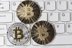 BTC Bitcoin coins on keyboard Stock Image