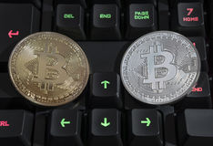 BTC Bitcoin coins on keyboard Royalty Free Stock Photography
