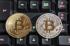 BTC Bitcoin coins on keyboard Royalty Free Stock Images