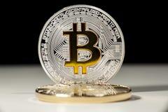 BTC Bitcoin coins. Shining metal BTC bitcoin coins on black and white background Royalty Free Stock Photos