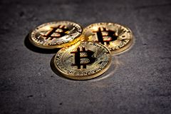 BTC Bitcoin coins. Shining metal BTC bitcoin coins on grey background Stock Images