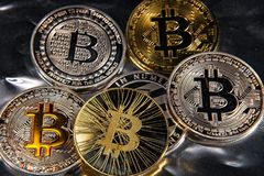 BTC Bitcoin coins. Shining metal BTC bitcoin coins on on silver background Royalty Free Stock Photo