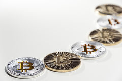 BTC Bitcoin coins. Shining metal BTC bitcoin coins on white background royalty free stock image