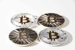 BTC Bitcoin coins. Shining metal BTC bitcoin coins on white background Stock Images
