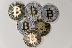 BTC Bitcoin coins. Shining metal BTC bitcoin coins on white background Royalty Free Stock Images