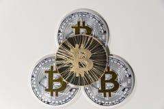 BTC Bitcoin coins. Shining metal BTC bitcoin coins on white background Stock Photography