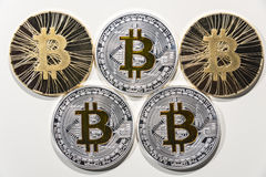 BTC Bitcoin coins. Shining metal BTC bitcoin coins on white background Royalty Free Stock Photography