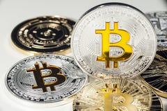 BTC Bitcoin coins. Shining metal BTC bitcoin coins on white background Stock Photos