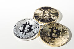 BTC Bitcoin coins. Shining metal BTC bitcoin coins on white background stock photo