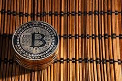 BTC Bitcoin coins. Shining metal BTC bitcoin coins on wood mat Stock Image