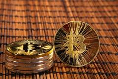 BTC Bitcoin coins. Shining metal BTC bitcoin coins on wood mat Royalty Free Stock Photos
