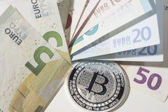 BTC Bitcoin and Euro bank notes Royalty Free Stock Photography