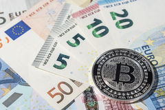BTC Bitcoin and Euro bank notes Royalty Free Stock Photo