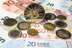 BTC Bitcoin and Euro coins and notes Stock Photography