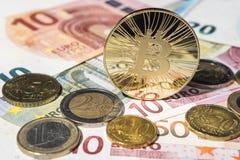 BTC Bitcoin and Euro coins and notes Stock Photos