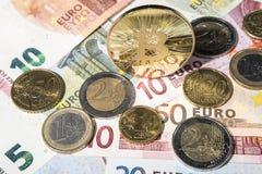 BTC Bitcoin and Euro coins and notes Royalty Free Stock Photos