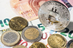 BTC Bitcoin and Euro coins and notes Stock Image