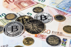 BTC Bitcoin and Euro coins and notes Royalty Free Stock Image