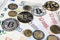 BTC Bitcoin and Euro coins and notes Stock Images