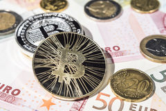 BTC Bitcoin and Euro coins and notes Royalty Free Stock Photo