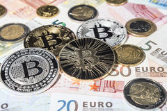 BTC Bitcoin and Euro coins and notes Royalty Free Stock Images