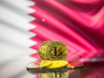 Bitcoin gold coin and defocused flag of Bahrain background. Virtual cryptocurrency concept. royalty free stock photo