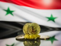 Bitcoin gold coin and defocused flag of Syria background. Virtual cryptocurrency concept. royalty free stock photos