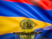 Bitcoin gold coin and defocused flag of Armenia background. Virtual cryptocurrency concept. stock photo