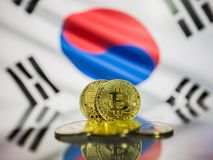 Bitcoin gold coin and defocused flag of South Korea background. Virtual cryptocurrency concept. stock photos