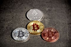 BTC and ETH, Bitcoin and Ethereum coins royalty free stock images