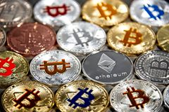 BTC and ETH, Bitcoin and Ethereum coins royalty free stock photography