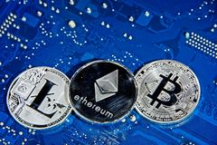 BTC LTC ETH Bitcoin Litecoin Ethereum coins on circuit board Stock Photography