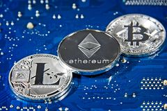 BTC LTC ETH Bitcoin Litecoin Ethereum coins on circuit board Royalty Free Stock Photography