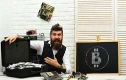 BTC mining is profitable. Bearded man with cash money. From paper money to crypto currency. Bearded hipster with bitcoin. Symbol and dollars. Business man in stock photo