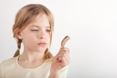 BTE hearing aid and a kid Royalty Free Stock Image