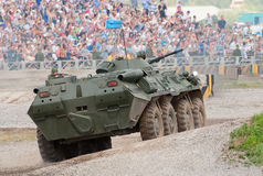 BTR-80 runs an obstacle course. ZHUKOVSKY, RUSSIA - JULY 1: BTR-80 APC runs an obstacle course on the Forum ET-2012 on July 01, 2012 in Zhukovsky, Russia Royalty Free Stock Images