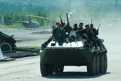 BTR-82A armoured personnel carrier with soldiers. Nizhniy Tagil, Russia - July 12. 2008: Group of special forces unload from BTR-82A armoured personnel carrier royalty free stock image