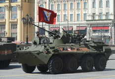 The BTR-82A is an Russian 8x8 wheeled amphibious armoured personnel carrier (APC) with Marines. Stock Photo