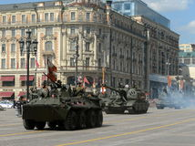 The BTR-82 is an  8x8 wheeled amphibious armoured personnel carrier  and the 2S19 Msta-S is self-propelled 152 mm howitzer. Stock Photography