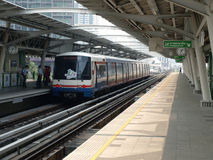 BTS or Sky Train at a Bangkok Station. BANGKOK - FEB 7: BTS Skytrain at a station on Sukhumvit Road as the BTS rail network celebrates its 10th anniversary of Royalty Free Stock Photos