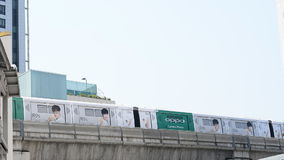 BTS Sky train mass transit system ,moving to arrive in platform of central business area of Bangkok. stock video