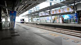 BTS or Skytrain in Bangkok Thailand. BTS or Skytrain stop receive people at Prathumwan Station in Bangkok Thailand stock footage