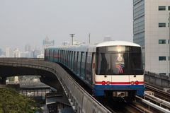 BTS Skytrain in Bangkok. Train BTS Skytrain arrives at the station Stock Images