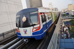 BTS Skytrain on Elevated Rails in Central Bangkok. A BTS (Bangkok Transit System) Skytrain on elevated rails above Sukhumvit Road on March 18, 2012 in Bangkok Royalty Free Stock Photo