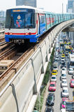 BTS Skytrain on Elevated Rails in Central Bangkok. A BTS (Bangkok Transit System) Skytrain on elevated rails above Phahonlayothin Road in Bangkok, Thailand Stock Image