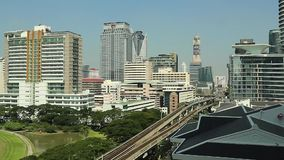 BTS Skytrain going opposite directions, in and out from the station stock video