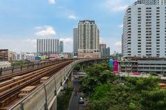BTS Skytrain rails, overhead bridge with buildings around Stock Photos